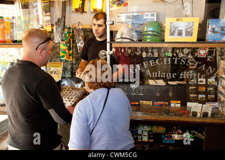 Tourists buying war trinkets at the entrance of Hitler's Bunker. Konewka Central Poland - Stock Photo