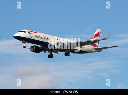 British Airways Embraer 190 regional jet on final approach - Stock Photo