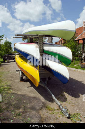 Kayaks canoes loaded on special transport trailer - Stock Photo