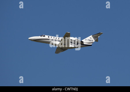Executive business jet aeroplane taking off at Manchester airport - Stock Photo