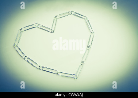 Heart made of paper clips - Stock Photo