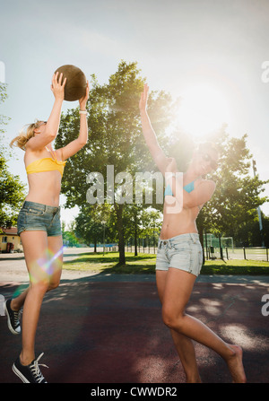 Teenage girls playing basketball - Stock Photo