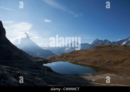 Aerial view of still lake in mountains - Stock Photo