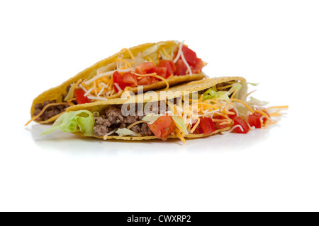Two Mexican tacos with hamburger meat, grated cheese, lettuce and tomatoes - Stock Photo