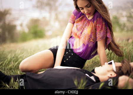 Young Couple In a Meadow - Stock Photo