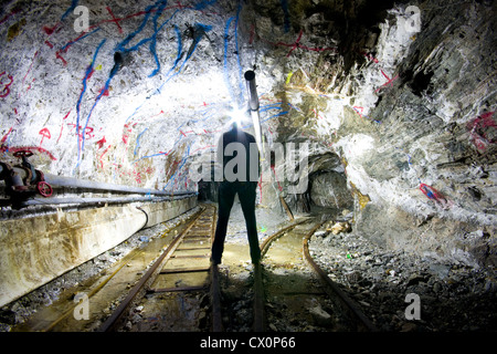 A person exploring a mine - Stock Photo