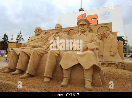 ITAR-TASS 60: MOSCOW, RUSSIA. MAY 1, 2010. Sand figures of the Tehran Conference's members Winston Churchill, Franklin - Stock Photo