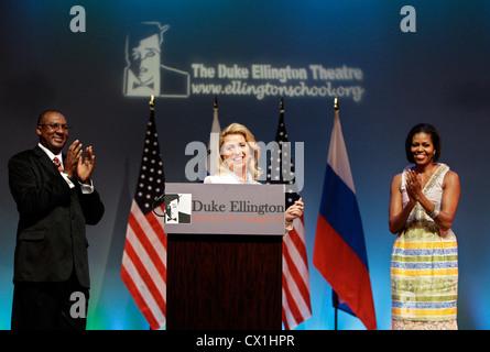 WASHINGTON, USA. JUNE 25, 2010. Wife of Russian President Dmitry Medvedev, Svetlana Medvedeva (L) gives a speech - Stock Photo