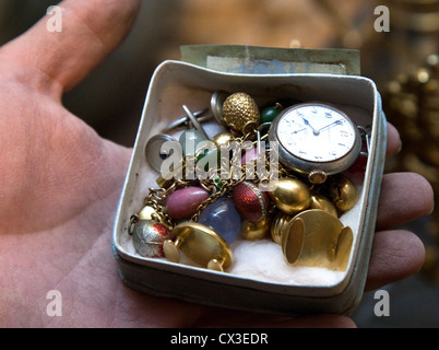 ITAR-TASS: ST PETERSBURG, RUSSIA. MARCH 29, 2012. A box with a pocket watch and jewellery discovered under the floor - Stock Photo