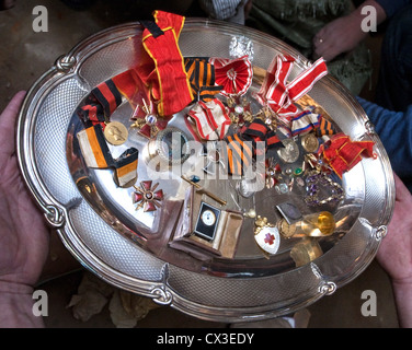 ITAR-TASS: ST PETERSBURG, RUSSIA. MARCH 29, 2012. A tray of Russian imperial medals and other decorations discovered - Stock Photo