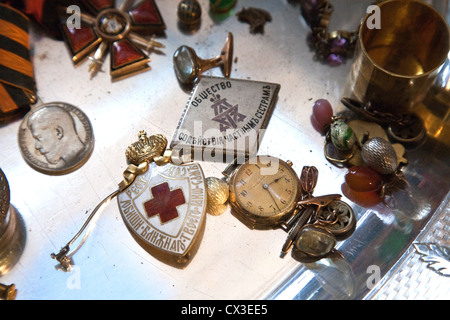 ITAR-TASS: ST PETERSBURG, RUSSIA. MARCH 29, 2012. A tray of Russian imperial medals, badges, watches and jewellery - Stock Photo