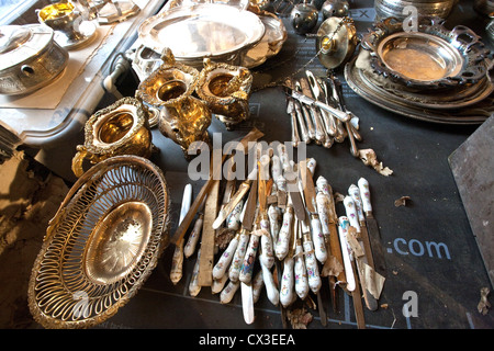 ITAR-TASS: ST PETERSBURG, RUSSIA. MARCH 29, 2012. Silver tableware discovered under the floor boards during renovation - Stock Photo
