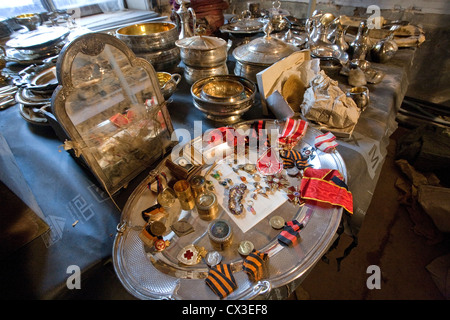 ITAR-TASS: ST PETERSBURG, RUSSIA. MARCH 29, 2012. Silver tableware, and Russian imperial decorations and insignia - Stock Photo