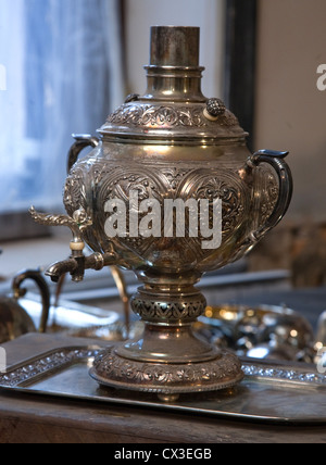 ITAR-TASS: ST PETERSBURG, RUSSIA. MARCH 29, 2012. A silver samovar and tableware discovered under the floor boards - Stock Photo