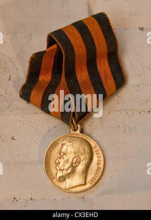 ITAR-TASS: ST PETERSBURG, RUSSIA. MARCH 29, 2012. A Russian imperial medal featuring Tsar Nicholas II of Russia - Stock Photo