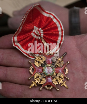 ITAR-TASS: ST PETERSBURG, RUSSIA. MARCH 29, 2012. A Russian imperial order of St. Stanislaus discovered under the - Stock Photo