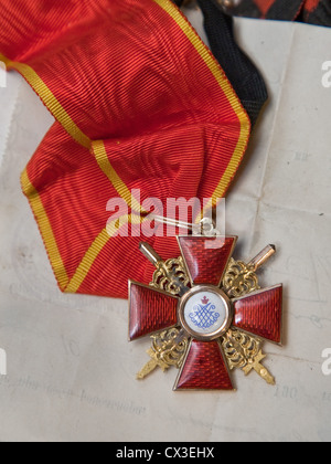 ITAR-TASS: ST PETERSBURG, RUSSIA. MARCH 29, 2012. A Russian imperial order of St Anna on a sash discovered under - Stock Photo