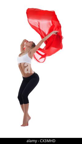 Junge, blonde Frau Tanz mit rotem Stoff isoliert fliegen - Stockfoto