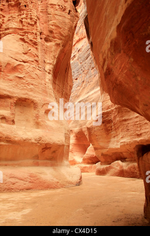 Rosy red walls of the Siq canyon, leading to the Treasury in Petra, Jordan. - Stock Photo