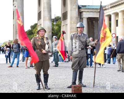 Berlin at the Brandenburg Gate with border guards posing to have your picture taken - Pariser Platz - Stock Photo