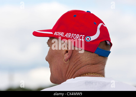 Man wearing Royal Air Force Red Arrows red hat at Best of British Show, Cotswold (Kemble EGBP) Airport. JMH6062 - Stock Photo