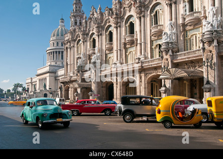 Old American Cars Passing Capitolio Building and Gran Teatro de la Habana, Paseo de Marti, Habana Vieja, Havana, - Stock Photo