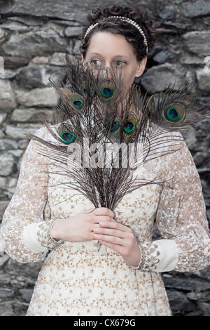 a woman with peacock feathers - Stock Photo