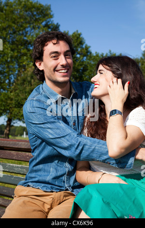 Intimate Couple on Bench - Stock Photo