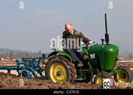 Old Fashioned Farmer Working In The Field Uk