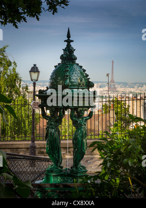 Beautiful public drinking fountain on the Montmartre butte in central Paris, France - Stock Photo