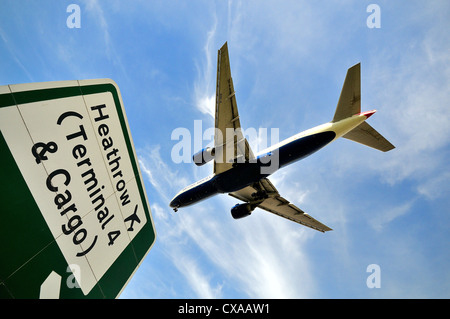 Passenger jet aircraft landing at Heathrow,London - Stock Photo