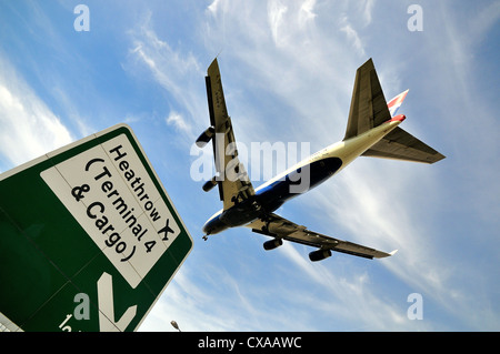 Passenger jet aircraft landing at Heathrow,London - Stock Photo
