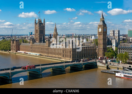 Buses crossing Westminster Bridge by Houses of Parliament, London, England, United Kingdom, Europe - Stock Photo