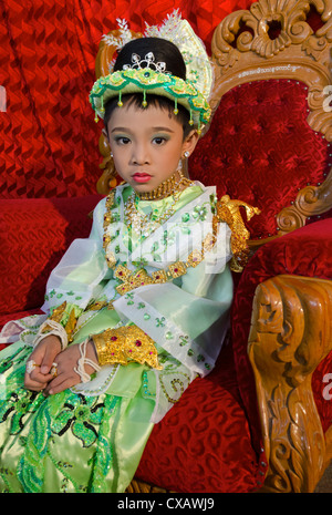 Young boy pausing during his noviciation ceremony, Taungyi, Shan State, Myanmar (Burma), Asia - Stock Photo