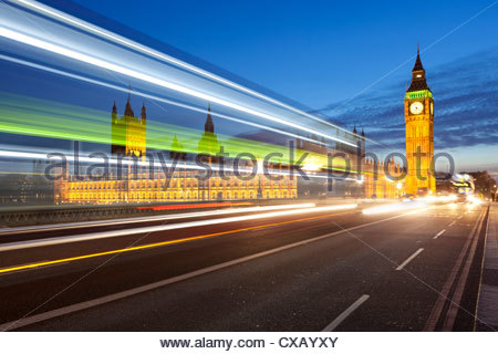Motion blurred bus on Westminster Bridge and Houses of Parliament, London, England, United Kingdom, Europe - Stock Photo
