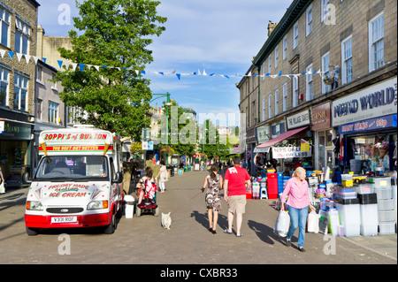 Buxton town Centre with Pound world shop and Ice cream van High Peak District Derbyshire England UK GB EU Europe - Stock Photo