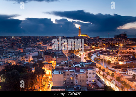 View over city with the Hassan II Mosque, the third largest mosque in the world in the bakcground, Casablanca, Morocco - Stock Photo