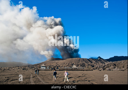 Tourists watching Mount Bromo volcanic eruption, East Java, Indonesia, Southeast Asia, Asia - Stock Photo