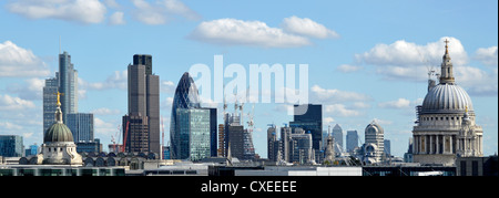 City of London skyline buildings including Tower 42, Gherkin, Lloyds, Canary Wharf distant, & Dome of St Pauls cathedral - Stock Photo