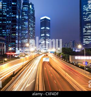 light trails on shanghai financial center at night - Stockfoto