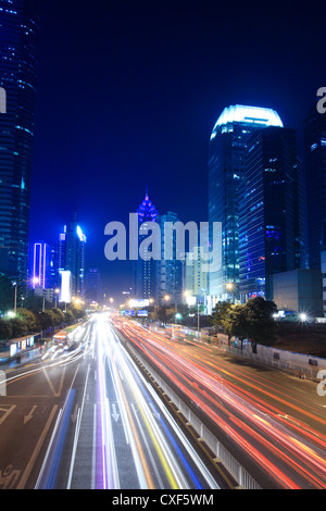 light trails on the street with building background - Stockfoto
