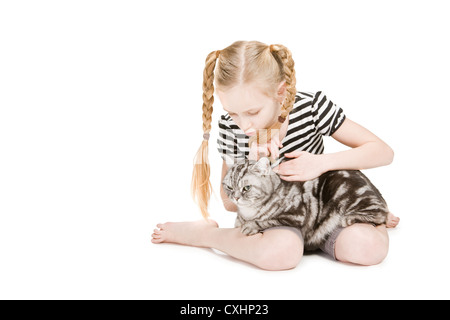 Young girl posing with british shorthair cat - Stock Photo