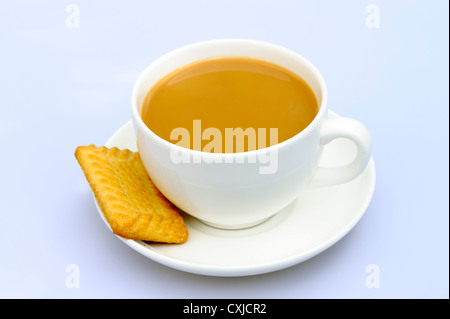 Cup of tea in a plain white cup & saucer. Tea and biscuit, UK. - Stock Photo