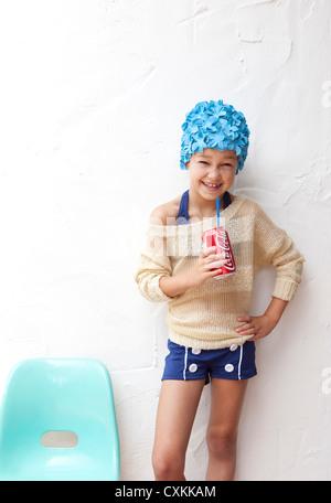 Girl in bathing suit drinking soda - Stock Photo