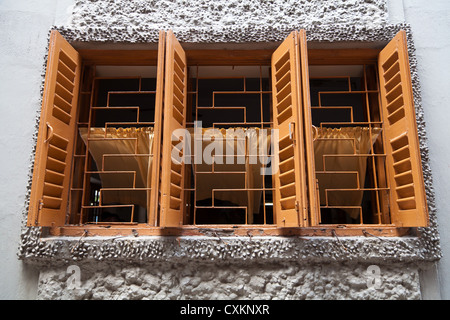 Windows of the Mother House of Mother Teresa in Kolkata in India - Stock Photo