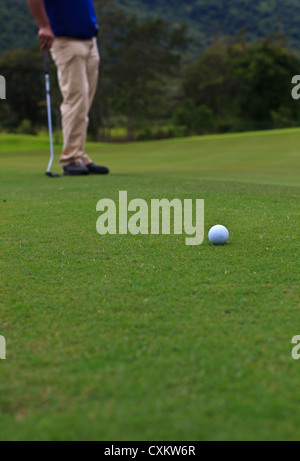 Golf player on the green - Stock Photo