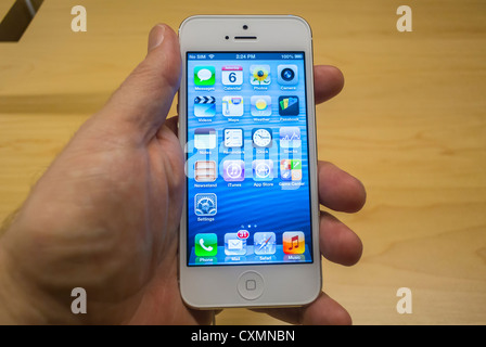 a iphone 5 up of a holding iphone 5 with a thumb being 10021