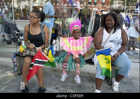 U.S.A.: Brooklyn, NY. Costumed girl awaits the start of the Caribbean Kiddies Carnival in Crown Heights, 2012. - Stock Photo