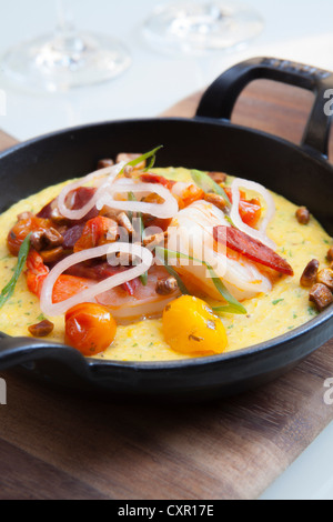 Dish of grits with shrimp in a skillet - Stock Photo