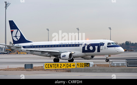 LOT Embraer 170-200LR airplane taxiing to the runway at Munich Airport, Bavaria, Germany, Europe - Stock Photo